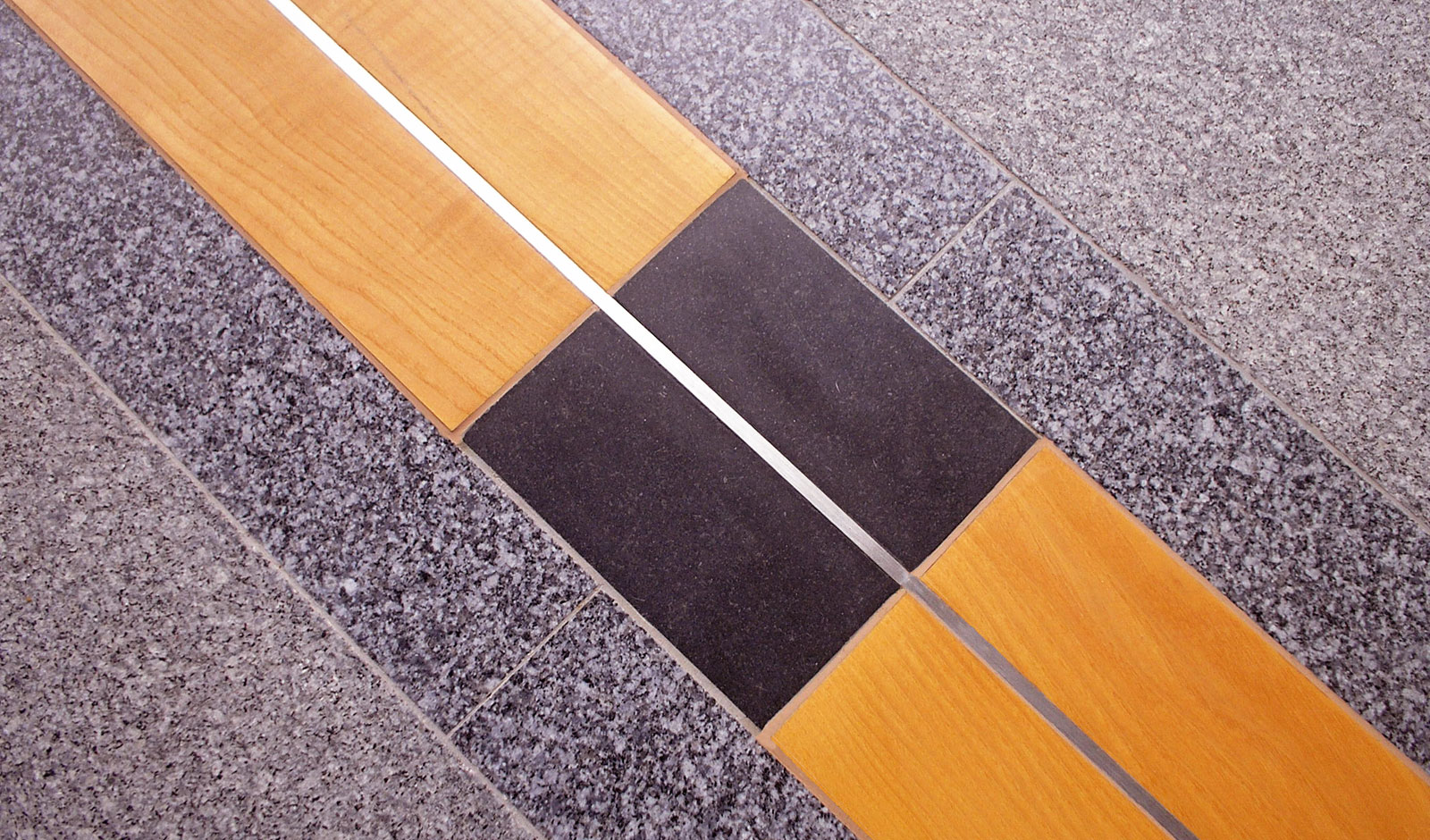 atrium floor detail in stone, metal and  treated wood